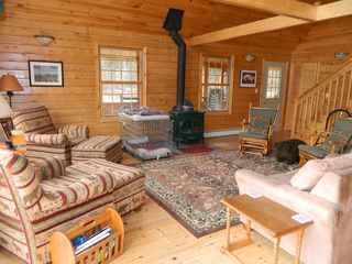 Carrabassett Valley house photo - Open living room, hardwood floors, wood burning stove.