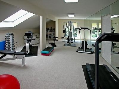 Mirrored Exercise Room with cardio equipment, free weights & more....