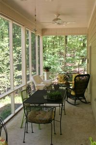 Back screened porch overlooking woods