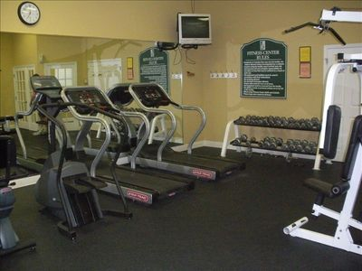 Exercise room complete with weights and a variety of machines.