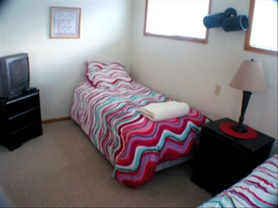 THIS SMALL ROOM HAD 2 TWIN BED AND A TV. PERFECT FOR CHILDREN.