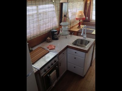 Full galley with full size fridge/freezer 3 burner stove/oven