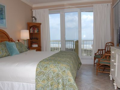 Amelia Island condo rental - Master bedroom has king bed and opens to patio. Sleep to the sound of the waves.