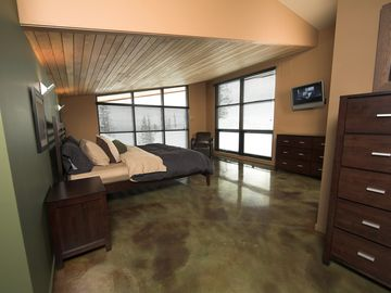 Up 1/2 level from the Guest Bedrooms & Ski Hall, the spiral staircase ends at the Master Suite: Crescendo's pinnacle.