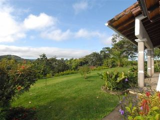 Nuevo Arenal house photo - Majestic views of rainforest and Lake Arenal