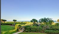Beachfront 3 bed/3bath condo with exquisite furnishings ..Dogs welcome!