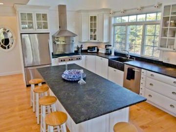 Fully-Equipped Kitchen Has Stainless Appliances, Farmer's Sink & Granite Countertops