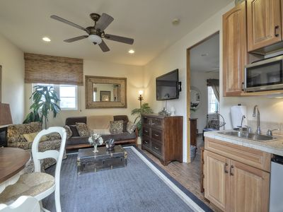 Casita living area w/ futon, dining, kitchenette, flat screen tv, & prvt. patio