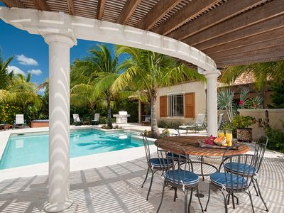 Providenciales - Provo villa rental - The shaded dining area at pool side is a great spot to dine and watch kids.