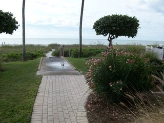 Sanibel Island condo photo - Enjoy the Flower gardens on the walkway to the beach.