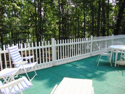 12 x 30 sundeck overlooking trees and lake