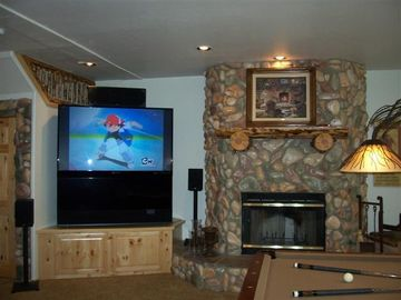 "Game Room: 60"" HD projection TV with DVD, video game hookups and ipod dock"