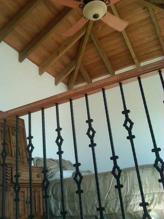 The Loft! Vaulted ceilings, breezes,views! Nicest railings on North Caicos!!!