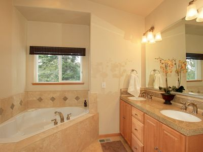 Master bathroom with seperate shower and spa tub