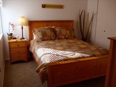 Bed Room: Warm decor with queen bed.