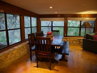 Dining table with seats for 8-9. - Wimberley house vacation rental photo