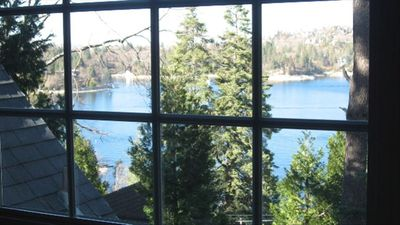 There are lake views from almost every room in the cottage, set amid tall pines