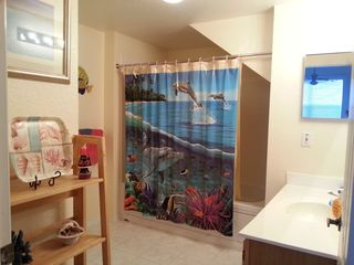 Venetian Bay townhome photo - Master bath with jacuzzi tub adjacent walk in closet and Master waterfront suite