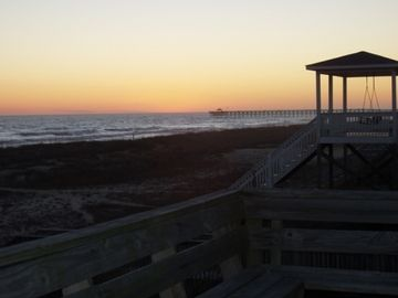 Sunset from the deck with view of pier