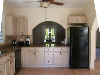 Rincon house photo - Fully equipped kitchen with arch pass thru to dining room.