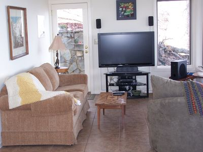 "Asheville cabin rental - Family room with 47"" flat screen TV and video library."