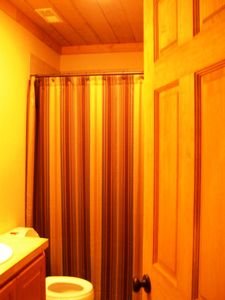 Cashiers house rental - Upstairs Guest Bath has single vanity and tub/shower