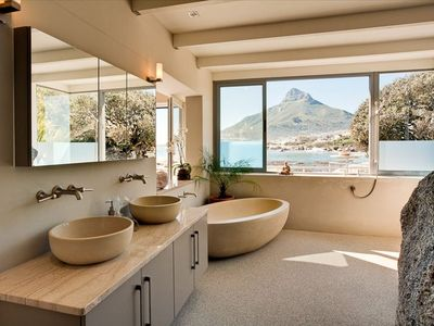 Interior of Master Bathroom with a natural rock wall