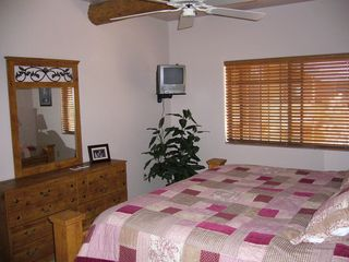 Pinetop condo photo - View of Master bedroom with ceiling fan and wall mounted TV