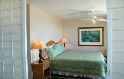 The master bedroom opens to the lanai and the ocean. Hear the surf!