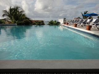 Pelican Key condo photo - Infinity pool and restaurant at La Vista (common pool)