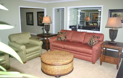 Relax or watch TV in 1 of 2 living areas with flat screen TV/DVD and wet bar