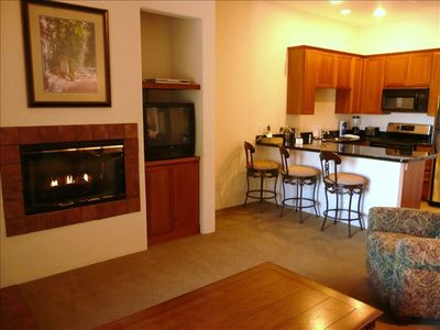 Quality furnishings, granite counters, and a cozy fireplace