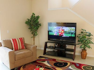 "Living room with 55"" LCD TV, CD player and free wireless highspeed internet"