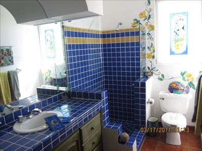 Both BR's have large, spacious & bright - private, colorful bathrooms en suite