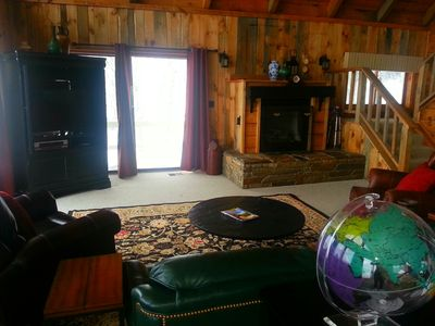 Large family room, gas fireplace, TV cabinet holds big LED Tv, Leather furniture