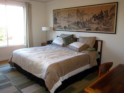 Antique Japanese screens and wall hangings adorn the king bedroom