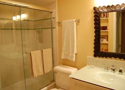 Marble and Glass Tile Bathrooms one with shower one with tub.
