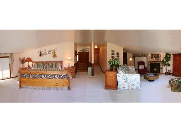 'Honeymoon Suite' with king bed, fireplace, Jacuzzi, TV, sitting room & balcony.