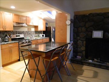 kitchen with an isle siting 6 and fire place