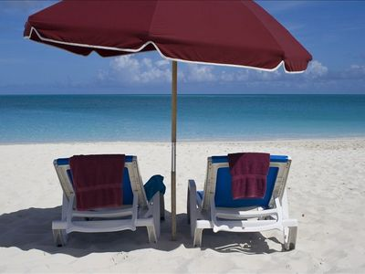 Beach umbrella and lounge chairs provided with rental