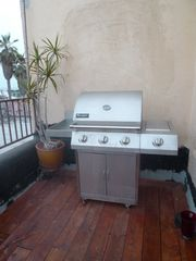 Los Angeles house photo - Four burner gas grill, back sun deck. great views of the ocean and sheltered