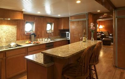 Main Galley (kitchen), fully complimented with top level appliances.
