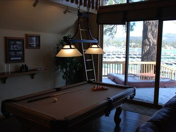 Pool table in the great room. Spa on deck can be seen in the background.