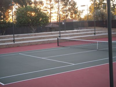 one of 8 tennis courts on property