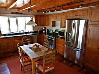Santa Fe house photo - Gourmet kitchen with full size fridge, gas range & oven, dishwasher, microwave