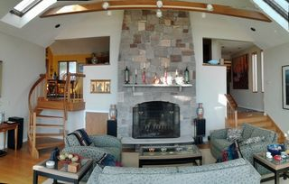 Living Room with fireplace, cathedral ceilings, wall of glass overlooking ocean - Plymouth house vacation rental photo