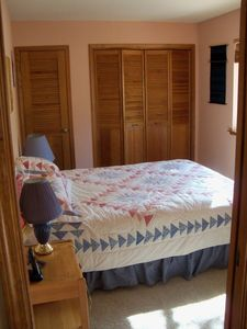 Second Bedroom with Queen Bed and Ample Closets