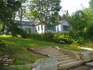 Baddeck house photo - View of Boat Cottage from the Kids' Beach, Steps, and Dock Area