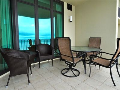 Relax on the Balcony with 6 chairs and 2 chaise lounges (not pictured)