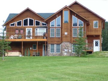 Lead house rental - Hilltop Lodge sits on 3 acres with a wrap-around deck. Beautiful views!